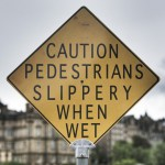 Caution pedestrians slippery when wet sign