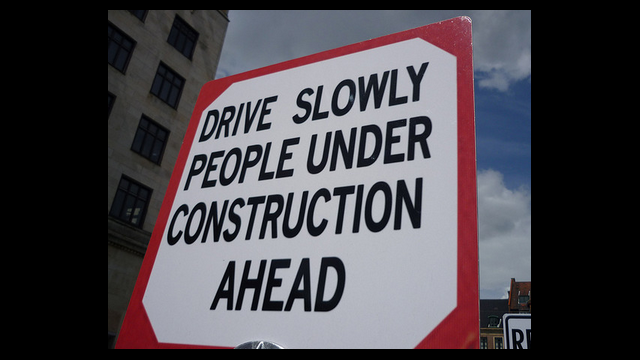 funny sign - drive slowly people under construction ahead