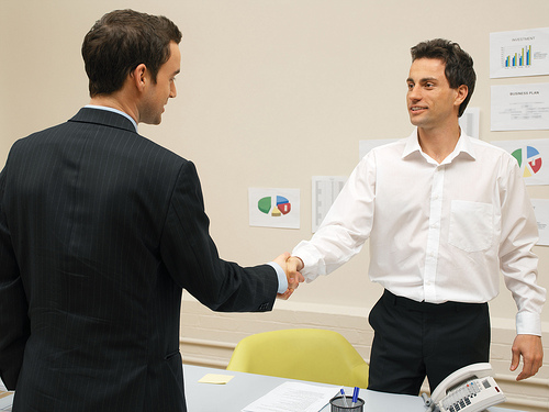 businessman shaking hands with one of his vendors