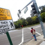 Cheeky crossing signs take on those who text and walk