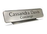 Engraved nameplates are available with a brass or silver - aluminum desk holder.